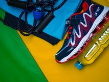 Creative flat lay of sport and fitness equipments on yellow green background with copy space. Creative flat lay of sport and fitness equipments clothes, shoe royalty free stock images