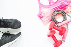 Creative flat lay of sport and fitness equipments on white background Royalty Free Stock Photos