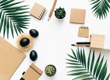 Creative flat lay stationery with black Easter eggs stock image