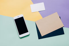 Creative flat lay style workspace desk with smartphone Stock Photography