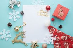 Creative flat lay of white blank paper for text with Merry Chris. Tmas and Happy New Year concept on blue pastel color Royalty Free Stock Photos