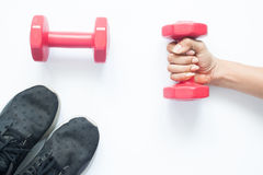 Creative flat lay of woman hand holding red dumbbell Stock Photography