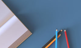 Creative flat lay work space with Book ,pencil on table. Creative flat lay design of work space desk with Open Book and pencil on Blue table top view Royalty Free Stock Image