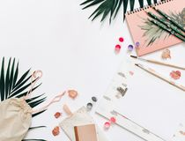Creative flat lay workspace with brush,. Pencils and paints, designer concept royalty free stock photos