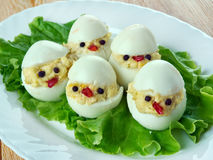 Creative food concept. Brood of chickens, made from eggs, sauce and vegetables. kids menu Stock Images