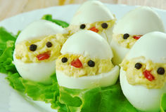Creative food concept. Brood of chickens, made from eggs, sauce and vegetables. kids menu Stock Photos
