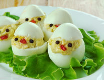 Creative food concept. Brood of chickens, made from eggs, sauce and vegetables. kids menu Stock Photography