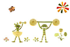 Creative food concept. Children sportsmen made from kiwi Royalty Free Stock Photography