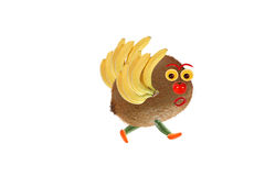 Creative food concept. Funny little bird, made of fruits and veg Royalty Free Stock Images