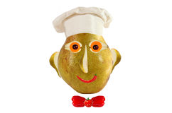 Creative food concept. Funny portrait of a cook, made of pear, f Stock Photo