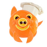 Creative food concept. Little Chef is a funny pig made from oran Stock Photography