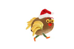 Creative food concept. Little funny bird made from kiwi and banans. Happy New Year. royalty free stock images