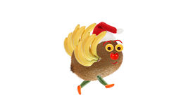 Creative food concept. Little funny bird made from kiwi and banans. Happy New Year. royalty free stock photography