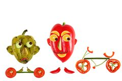 Creative food concept. Positive and negative funny little pepper Stock Image