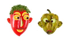 Creative food concept. Positive and negative portraits. Made of green and red peppers Royalty Free Stock Image
