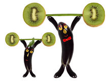 Creative food concept. Two funny eggplant raise the bar of kiwi Stock Image