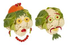 Creative food. Portrait two old man made of vegetables. And fruits Royalty Free Stock Photos