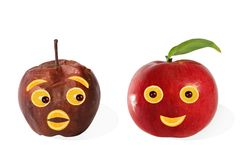 Creative food. Positive and negative portraits made ??from apple Stock Photography