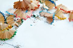 Creative frame made of color pencil shavings a on a white paper. Royalty Free Stock Images