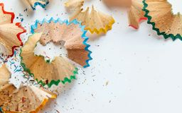 Creative frame made of color pencil shavings a on a white paper. Stock Photo