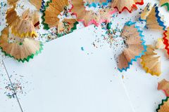Creative frame made of color pencil shavings a on a white paper. Stock Images