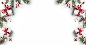 Free Creative Frame Made Of Christmas Fir Branches, Gift Boxes, Red Decoration, Sparkles And Confetti On White Background. Xmas And New Royalty Free Stock Photography - 161386357