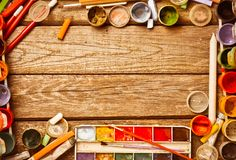 Creative frame from products for drawing and creation. Watercolors, gouache, oil paint, colored pencils, crayons layout on a wooden table. Top view stock images