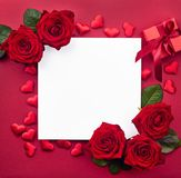 Creative frame of red roses, gift box and hearts. With blank paper note Royalty Free Stock Photos