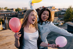 Creative friends birthday party outdoors. Female friendship, happy celebration Royalty Free Stock Images