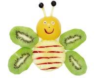Creative fruit child dessert bee form Stock Image