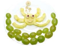 Creative fruit child dessert crab form Stock Images