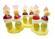 Creative fruit child dessert faces form Stock Image