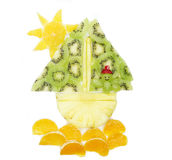 Creative fruit child dessert man sailing in the ship form Royalty Free Stock Photos
