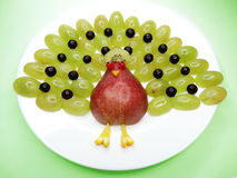 Creative fruit child dessert peacock form Stock Images