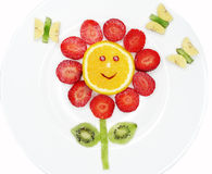 Creative fruit child dessert red flower and butterflies form. Creative fruit dessert for child funny form red flower and butterflies royalty free stock photos
