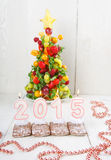 Creative fruit Christmas tree with different berries, fruits and Royalty Free Stock Image
