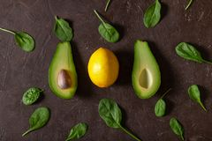 Creative fruit and vegetable pattern. Avocado, lemon, spinach stock images
