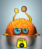 Creative funny orange monster. Cartoon cute furry monster with beware of monsters sign Royalty Free Stock Photos