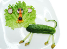 Creative funny vegetable snack with cucumber Stock Image