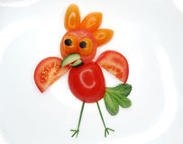 Creative funny vegetable snack with tomato Stock Photos