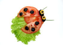 Creative funny vegetable snack with tomato Royalty Free Stock Photos