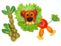 Creative funny vegetable snack with tomato Royalty Free Stock Image