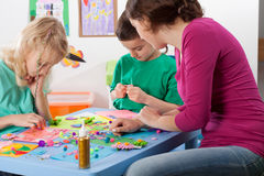 Creative games in kindergarden. Kids and a teacher playing creative games in kindergarden Royalty Free Stock Photos