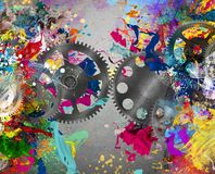 Creative gear. Gears on background of colorful splash painting Stock Photography