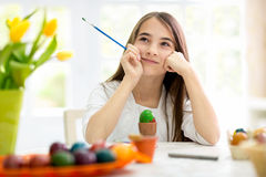 Creative girl with Easter eggs Stock Image