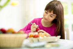 Creative girl painting Easter eggs Royalty Free Stock Images