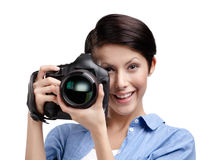 Creative girl-photographer takes pictures Stock Photos