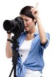 Creative girl-photographer takes shots Royalty Free Stock Photography