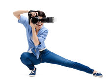 Creative girl-photographer takes snaps Royalty Free Stock Images