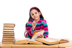 Creative girl with pile of books Stock Image